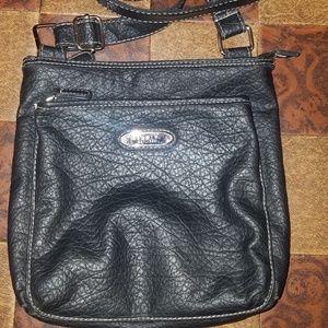 Rosetti black crossbody style purse.